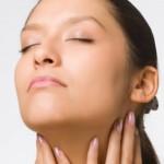 Woman feeling skin after having Electrolysis hair removal